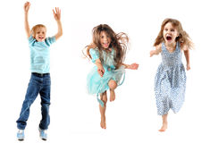 Children jumping. Happy children jumping and dancing. Isolated over white royalty free stock photos