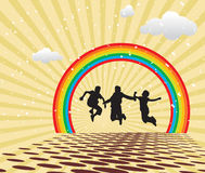 Children Jumping. Against multi colored backgrounds and rainbow Royalty Free Stock Photo