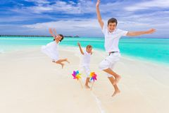 Children jumping on beach stock image