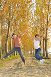 Children jumping in forest Royalty Free Stock Image