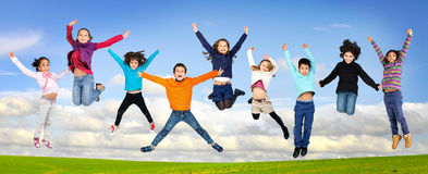 Children jumping Stock Photography