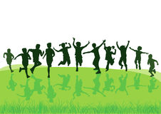 Children jumping in meadow Royalty Free Stock Photo