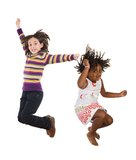 Children jumping at once. Two happy children jumping at once on a white background Royalty Free Stock Photography