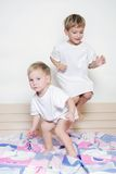 Children jumping on parent's bed Stock Images