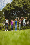 Children jumping at park Royalty Free Stock Photo