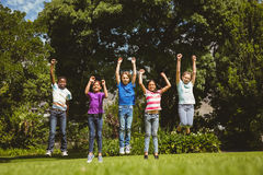 Children jumping at park Stock Photos