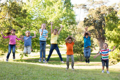 Children jumping in the park. On a sunny day Stock Images