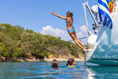Children jumping from the sailboat. In the sea Stock Photography
