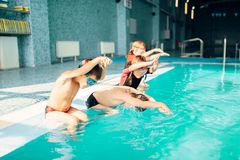 Children jumping into sport swimming pool. Sporty kids. Boys doing exercise in swimming pool. Clean blue water. Healthy and happy childhood concept. Funny Stock Photography