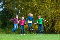 Children jumping together Royalty Free Stock Photo