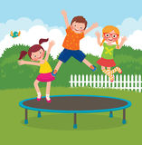 Children jumping on the trampoline Stock Image