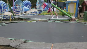 Children jumping on the trampoline in the summer park stock video