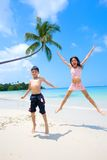 Children jumping up high at the beach Royalty Free Stock Image