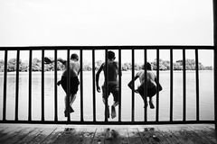 Children jumping from waterfront royalty free stock photography