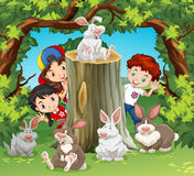 Children in the jungle with rabbits Royalty Free Stock Photos