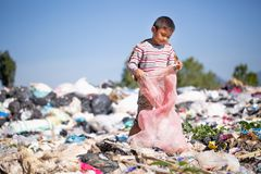 Children are junk to keep going to sell because of poverty, ,World Environment Day, Poverty concept stock photos