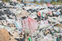 Children are junk to keep going to sell because of poverty, World Environment Day, Child labor,  human trafficking, Poverty. Children are junk to keep going to stock images