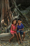 The children in Kampuchea. In Angkor,many local children wander around the scenic spots.They can say hello in English,Korea,Chinese etc,hoping that they can get Stock Photo