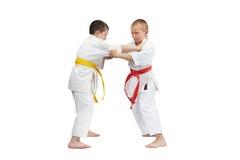 Children in karategi are doing capture of karategi Stock Photography