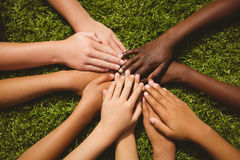 Children keeping hands together over grass Royalty Free Stock Images