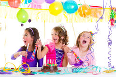Children kid in birthday party dancing happy laughing. With baloons serpentine and garlands Stock Photo