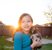 Children kid girl playing with puppy dog chihuahua Stock Photography