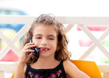 Children kid girl talking mobile phone Royalty Free Stock Images