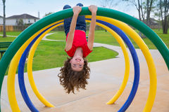 Children kid girl upside down on a park ring. Children kid girl upside down on a park playground ring game royalty free stock photos