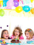 Children kid girls birthday party look excited chocolate cake Stock Photos