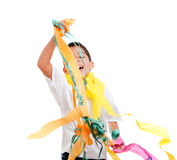 Children kid in a party with messy colorful paper Stock Photo