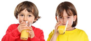 Children kids girl boy drinking orange juice healthy eating isolated on white stock photos