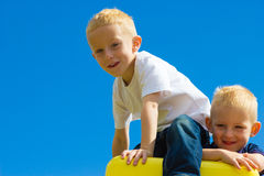 Children kids in playground climbing playing. Royalty Free Stock Images