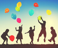 Children Kids Playing Balloons Innocence Concept Stock Images