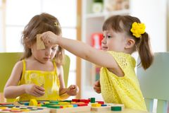 Children play educational toys in kindergarten royalty free stock images