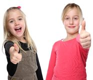 Children kids smiling young little girls success thumbs up isolated on white. Children kids smiling young little girls success thumbs up isolated on a white royalty free stock photos