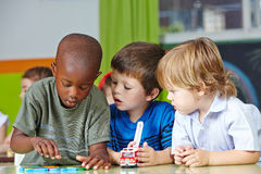 Children in kindergarten playing royalty free stock images