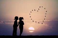 Children kissing at sunset Royalty Free Stock Images