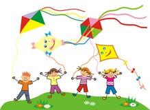 Children and kites Stock Photos