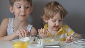 Children knead the dough. Add flour, sugar, eggs, butter stock video footage
