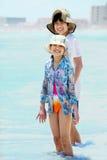 Children knee deep in ocean waves Stock Photography