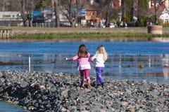 Children at lake stock image
