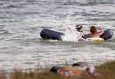 Children on lake Stock Image