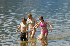 Children in the lake. Outdoor group image of children in water Royalty Free Stock Image