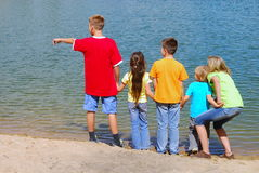 Children at lake shore stock photos