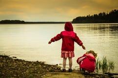 Children and lake Stock Photo