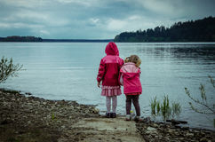 Children and lake Stock Photos