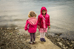 Children and lake Stock Images