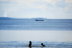 Children in Lake Victoria. Children play in the shallows of Lake Victoria on Ssese Islands in Uganda Stock Photography