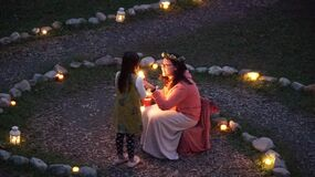 Children with lanterns outdoors Stock Image