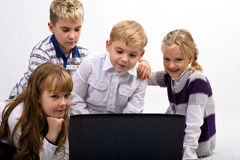 Children with laptop Royalty Free Stock Photography